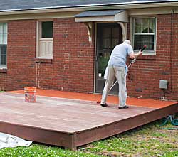 Deck being painted with Behr DeckOver
