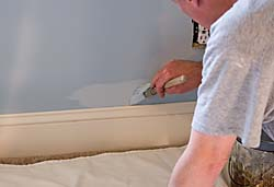 Mike Cushen cutting-in next to baseboard trim
