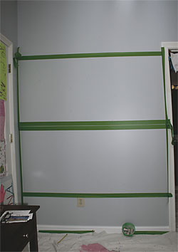 Wall and surrounding area taped and covered before using chalkboard paint.