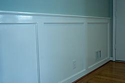 Foyer with painted wainscoting.