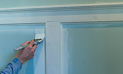 Priming the wainscoting.