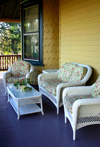 Grouping of painted white wicker furniture
